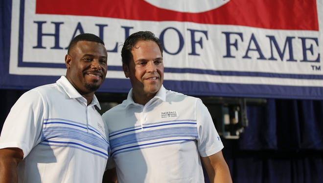 2016 National Baseball Hall of Fame inductees Ken Griffey Jr., left, and Mike Piazza, right, pose for a photo at the conclusion of a pre-induction press conference, Saturday, July 23, 2016, at the Clark Sports Center in Cooperstown, N.Y.