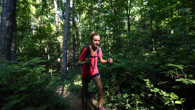 Nichole Young of Morristown walks through Wawayanda State Park finishing the New Jersey section during her thru-hike of the 2,190 mile Appalachian Trail. Young started at Springer Mountain in Georgia in April and will finish on Mount Katahdin in Maine sometime in October. July 23, 2016, Vernon Twp, NJ