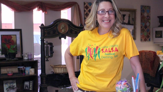 Debbie Seats sports a Luna County Salsa Festival T-shirt on Wednesday and anticipates checking out the two-day weekend event that will be held Saturday and Sunday, July 30-31, at Luna County Courthouse Park.