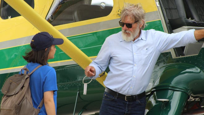 Harrison Ford, right, goes through a pre-flight briefing with Jodie Gawthrop of Westchester, Illinois, before the Experimental Aircraft Association's 2 millionth Young Eagle flight Thursday, July 28, 2016, at Wittman Regional Airport in Oshkosh, Wis.