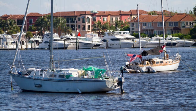 FILE - Two sail boats are anchored in Naples Bay near Naples Landings Park on Friday morning, Oct. 10, 2014. (Samuel Wilson/Staff)