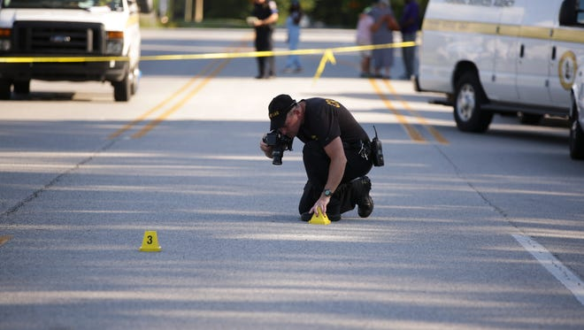 A photographer documents the crime scene of a homicide that took place at 5:17pm on July 30, 2016 on 5400 block of High School Road. The deceased appeared to be a male victim.