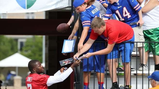 Bills rookie quarterback Cradle Jones signs autographs on the first day of training camp at St. John Fisher College.