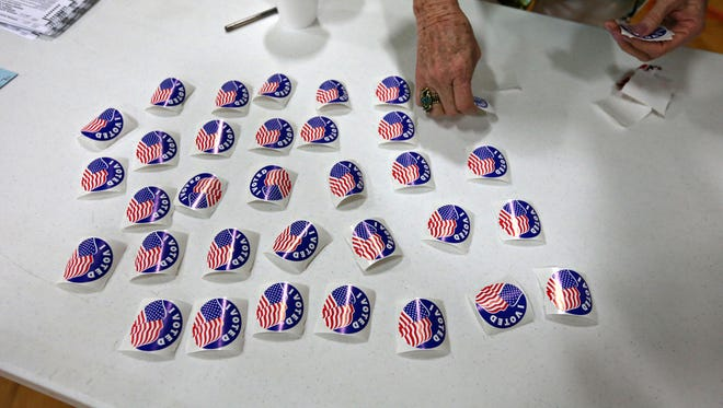 An election worker lays out the last of the voting stickers during a previous election day.