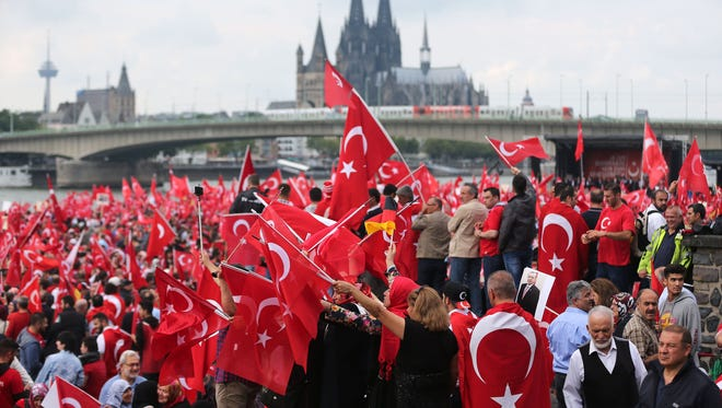 Supporters of Turkish President Recep Tayyip Erdogan attend a rally in Cologne, Germany, on July 31, 2016.