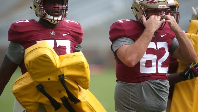 FSU offensive lineman Ethan Frith (right) is reportedly one of four Seminoles no longer on the roster.
