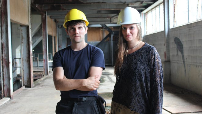 "German artists Vesko Goesel, 33, left, and Viktoria Strecker, 29, right, pictured in the Moran Plant in Burlington on Thursday, the site of their art exhibition titled ""Modes of Construction."""