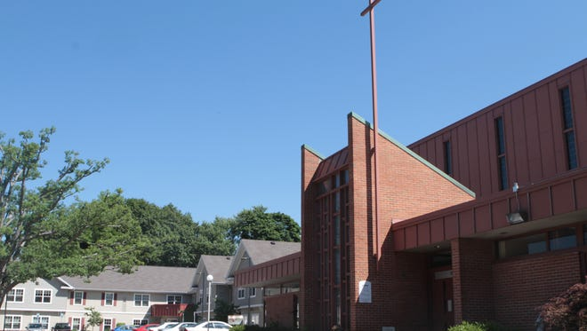 Providence Housing has proposed to turn Saint Salome Church on Culver Road into senior housing. Existing senior apartments, left, were fully opened in 2009.