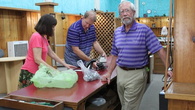 Sylvia Dorney, left, and Bill Dorney, right, work on downsizing the remaining items at their historic Greenbaum's Quilted Forest store. The couple closed the business on Monday, after attempting to sell the business and retire for over two years.