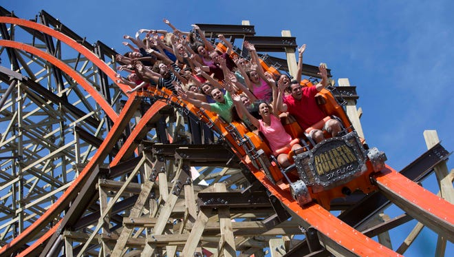 Mark Radek and Courtney Stachowiak (sitting in the third row) met on the Goliath wooden roller coaster at Six Flags Great America and are getting married Saturday.
