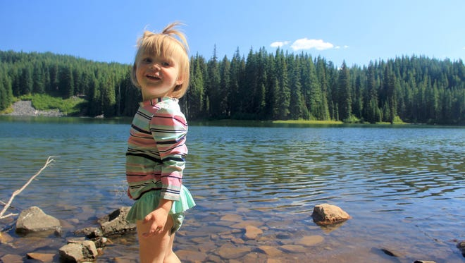 Lucy Urness plays in the water at Middle Erma Bell Lake in the Three Sisters Wilderness.