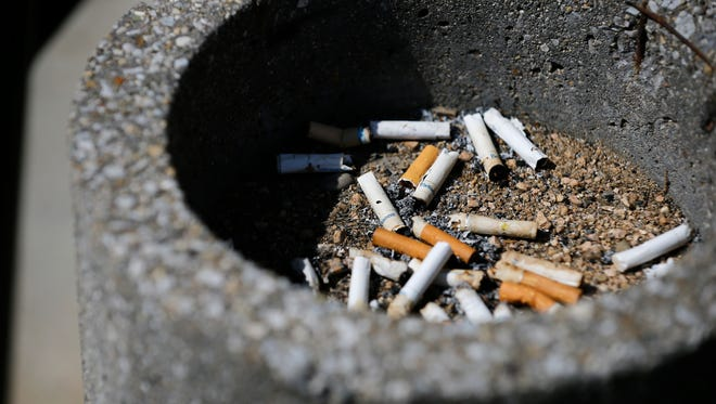 Discarded cigarettes lay in an ashtray outside of Baldwin Hall.