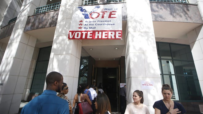 People wait in line to vote at the Leon County Courthouse during this year's March presidential primary.