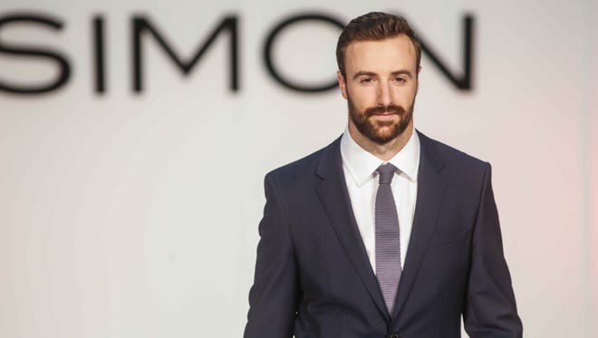 Hinchcliffe off the track in a suit from Nordstrom during the SP16 Luxe Fashion Show at the Fashion Mall on May 26.