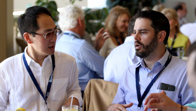 Evite.com CEO Victor Cho, left, and Don Osmond, managing partner of OzComm Marketing, discuss strategies at the Internet Marketing Association's IMPACT16 Cayman conference in April at the Ritz Carlton in Grand Cayman.