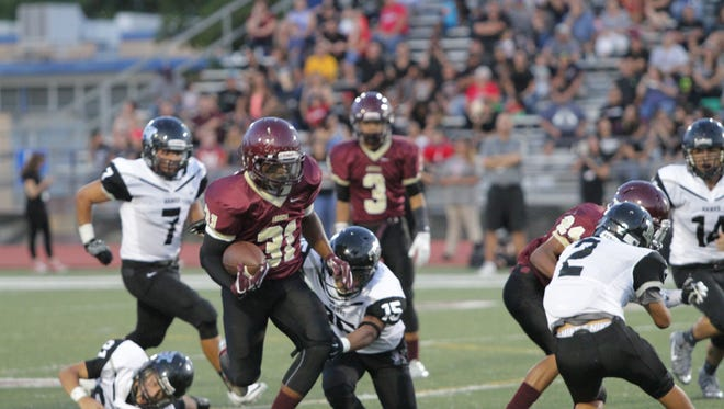 Andress wide receiver Jalen Joseph runs past the Hanks defense in Friday's 56-28 victory at home.