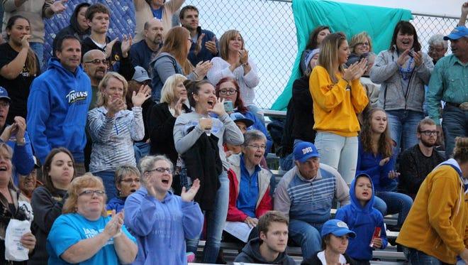 Dakota State fans support the Trojans last Friday night in Mitchell