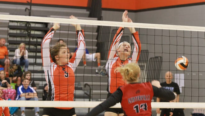Grinnell Tigers Kamryn Juni, 5, and Macy Harris, 3, miss blocking a a hit by Centerville's Madeline McDonald during a volleyball tourney held at Grinnell.