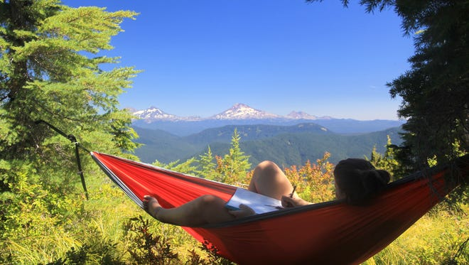 Hammocks make a great way to relax with a mountain view, in this case the Three Sisters.