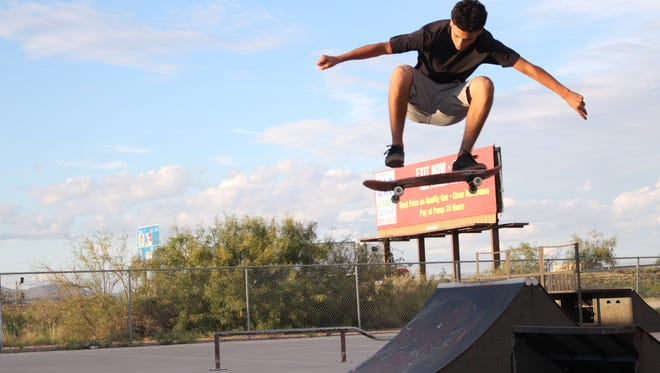 Daniel Lugo, 15, gets air off a broken ramp at the Deming skatepark. Lugo is part of a newly formed committee to seek funding for repairs for the current and possibly a new skatepark.