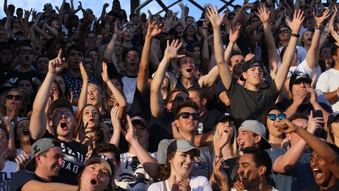 Football fans cheer during a 2016 Wolf Pack game at Mackay Stadium.