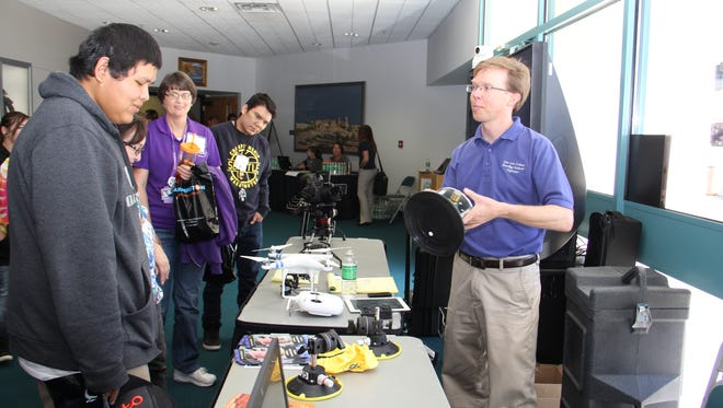 Luke Renner, associate professor of digital media arts and design at San Juan College, demonstrates equipment used in his classroom during the Technology Leadership Conference on Sept. 11, 2015, in the Henderson Fine Arts Center in Farmington.