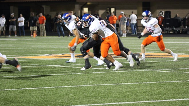 The Westlake defense swarms an Aledo ballcarrier during the Warriors' 65-7 loss to the Texas powerhouse.