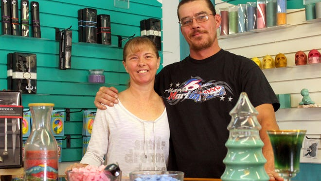 Brandon Curry and Rona Morrison offer more than just candles at their newly opened shop, Crafter's Hand. The shop sells customs etched glasses as well as handmade shelves and other goods to the community.