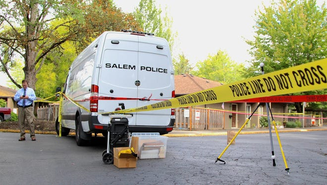 Salem police investigate the scene of a fatal shooting.