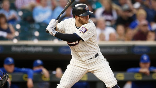 Minnesota Twins' Robbie Grossman bats against the Kansas City Royals in the first inning of a baseball game Wednesday, Sept. 7, 2016, in Minneapolis. (AP Photo/Jim Mone)