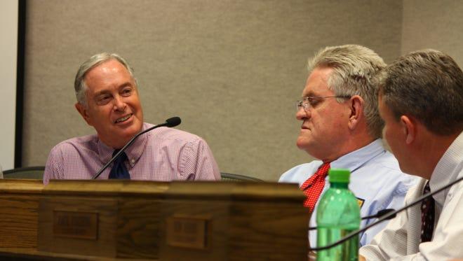 Cedar City councilmen Craig Isom, Fred Rowley and Paul Cozzens discuss the agenda on Wednesday, Sept. 7, 2016.