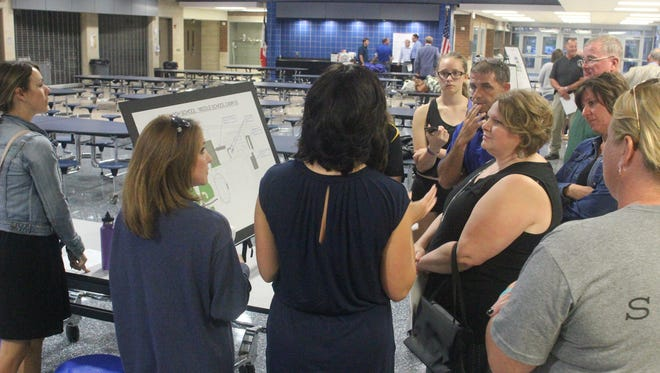 Clear Creek Amana School Board member Matt McAreavy, clockwise second from top listens as residents provide comment on one of the proposals for building a new school vs. additions to existing ones during the forum Thursday, Sept. 8.