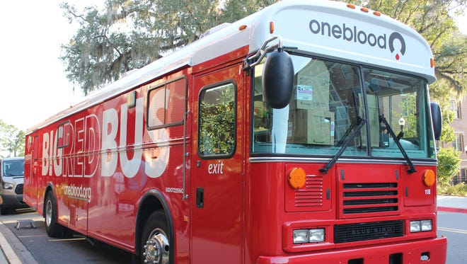 The Big Red Bus from OneBlood, a blood donation organization, parked right outside of the Askew Student Life Center.