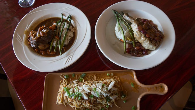 Clockwise from top left: osso bucco, lollipop pork chop and crab capellini.
