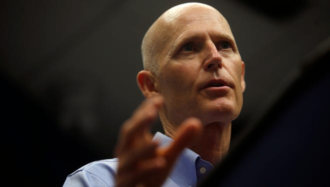 FILE - Gov. Rick Scott discusses Tropical Storm Colin and emergency preparedness practices for the state at the Florida Division of Emergency Management on Monday, June 6, 2016. (Joe Rondone/Democrat)