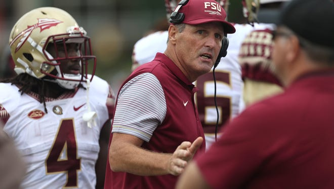 Tim Brewster, then Florida State's recruiting coordinator, talks to his team during their game against Louisville at Papa John's Cardinal Stadium in Louisville in 2016.