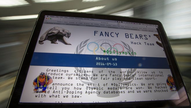 A screenshot of the Fancy Bears website is viewed on a screen in Moscow on Sept. 14, 2016.