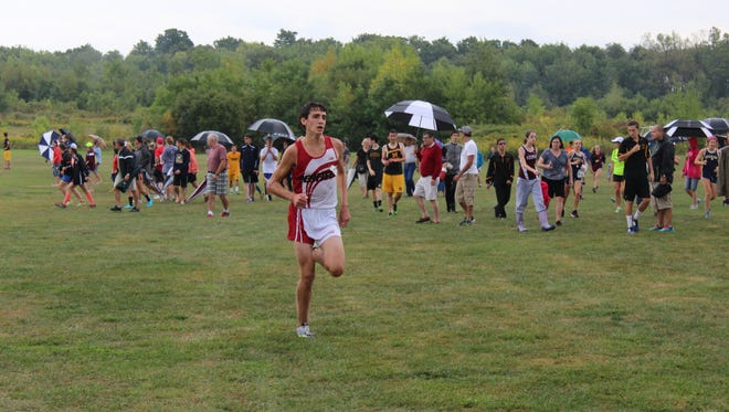 Tyler Senall of Penfield, pictured earlier this season at the Wayne Invitational, won the Section V Class A Championship over the same course, albeit with a lot more mud and water covering it.