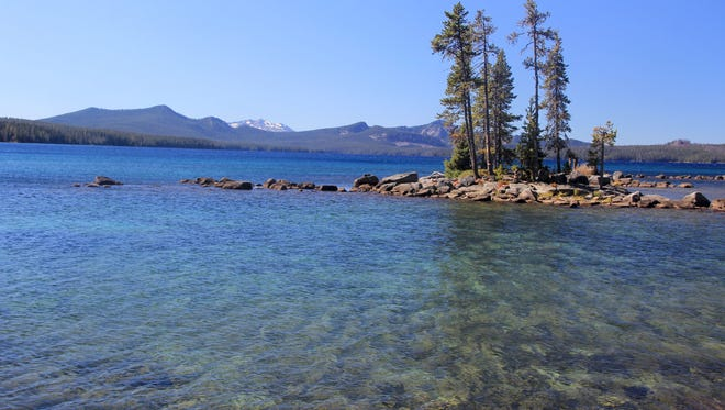 The islands at Waldo Lake are large and small. They can be visited for day use, but visitors cannot camp there.