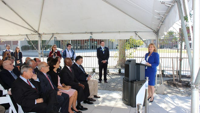 Lt. Gov. Kim Guadagno delivers the keynote address at the ribbon cutting for the new headquarters of the New Jersey Realtors in Trenton.