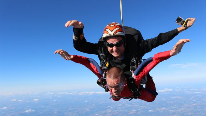 The Rev. Matthew Widder, pastor at Holy Name and St. Clement Catholic churches in Sheboygan, parachuted recently as part of a local school fundraiser.