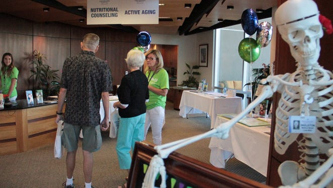 Southern Utah residents visit the Dixie Regional Medical Center for the LiVe Well Health Fair on Saturday, Sept. 24, 2016.