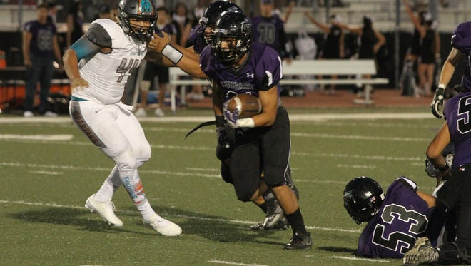 Franklin running back Seth Dominguez charges down field for a score Friday night in the teams' District 1-6A opener at Franklin.