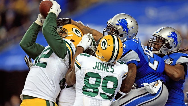 Tight end Richard Rodgers of the Green Bay Packers catches the game-winning touchdown as time expired to defeat the Detroit Lions 27-23 at Ford Field on December 3, 2015.