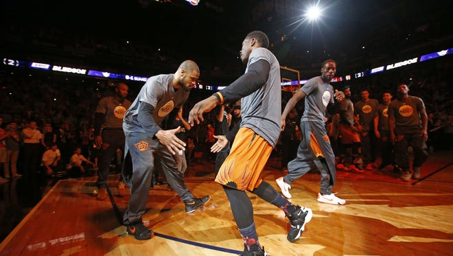 Phoenix Suns' Tyson Chandler and Eric Bledsoe during the player introductions during NBA action on Oct. 30, 2015 in Phoenix, Ariz.