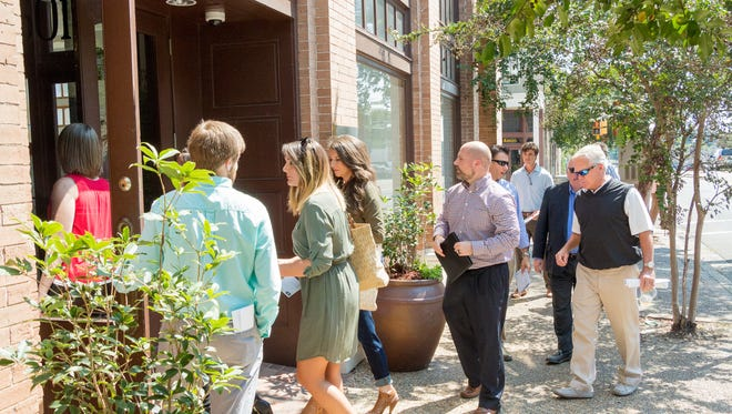 Realtors and investors tour downtown Hattiesburg during the recent Downtown Possibilities Tour. The HHDA recently received a $10,000 grant from Mississippi Power for facade improvement in the area.