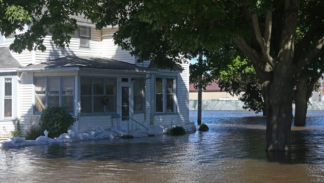 Floodwater from the Cedar River surrounds Jack and Peggy Harris' home on Monday, Sept. 26, 2016, in Vinton. Jack and Peggy said they did not think their home would flood again because it's in the 500-year flood plain.