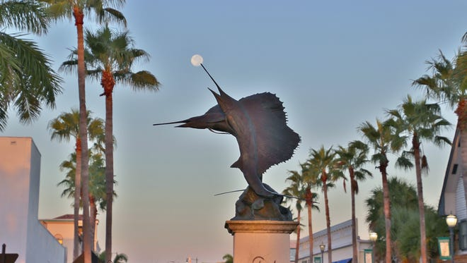 Terrie Selph took this photo of the full moon just after sunrise Aug. 19 being caught on the sailfish bill located at the roundabout in downtown Fort Pierce.