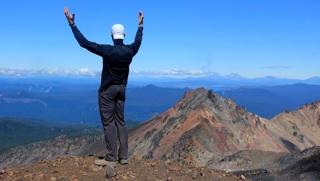 Tyler Dodds celebrates reaching the summit of Diamond Peak.