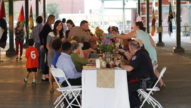 The fourth annual Season of Unity Dinner was held Tuesday night at the Farmer's Market.